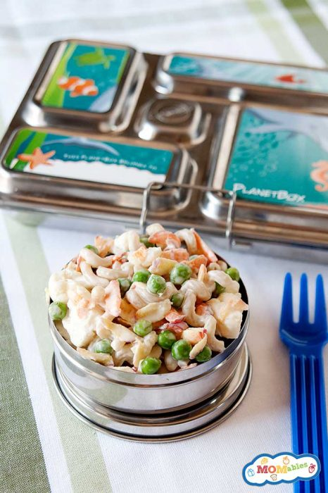 Cauliflower Crunch Pasta Salad in a tin meal container with a blue plastic fork.