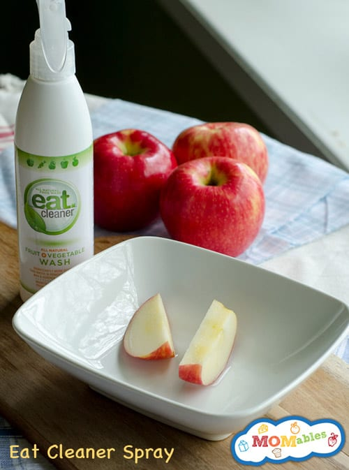 image: eat cleaner spray with apple slices in a shallow bowl