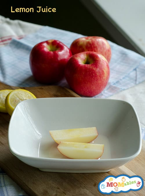 image: apple slices in a white bowl with lemon juice