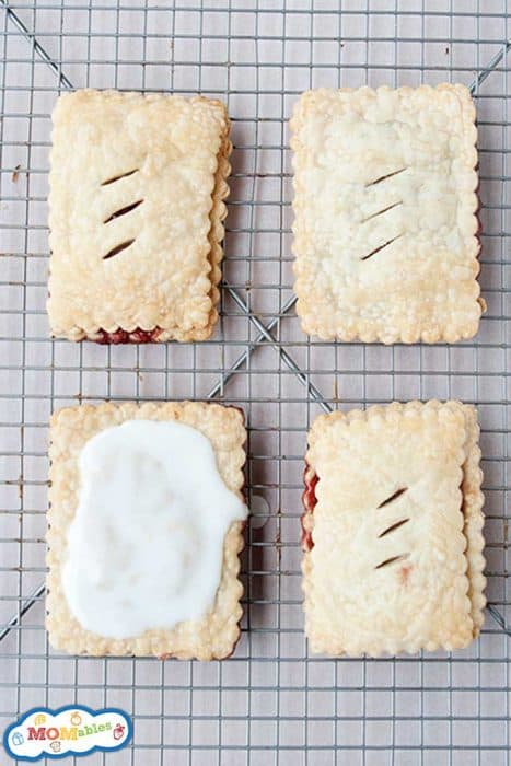 four homemade poptarts on a cooling rack, one of them frosted