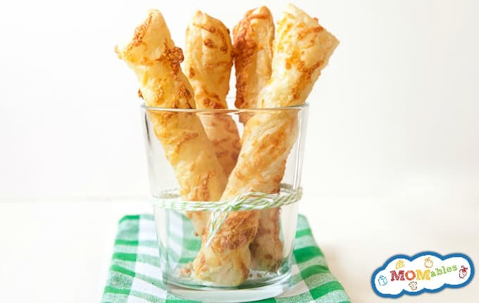 image: clear cup with 4 cheese straws standing inside