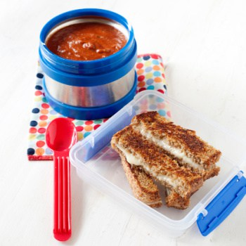thermos of tomato soup with small container of sliced grilled cheese