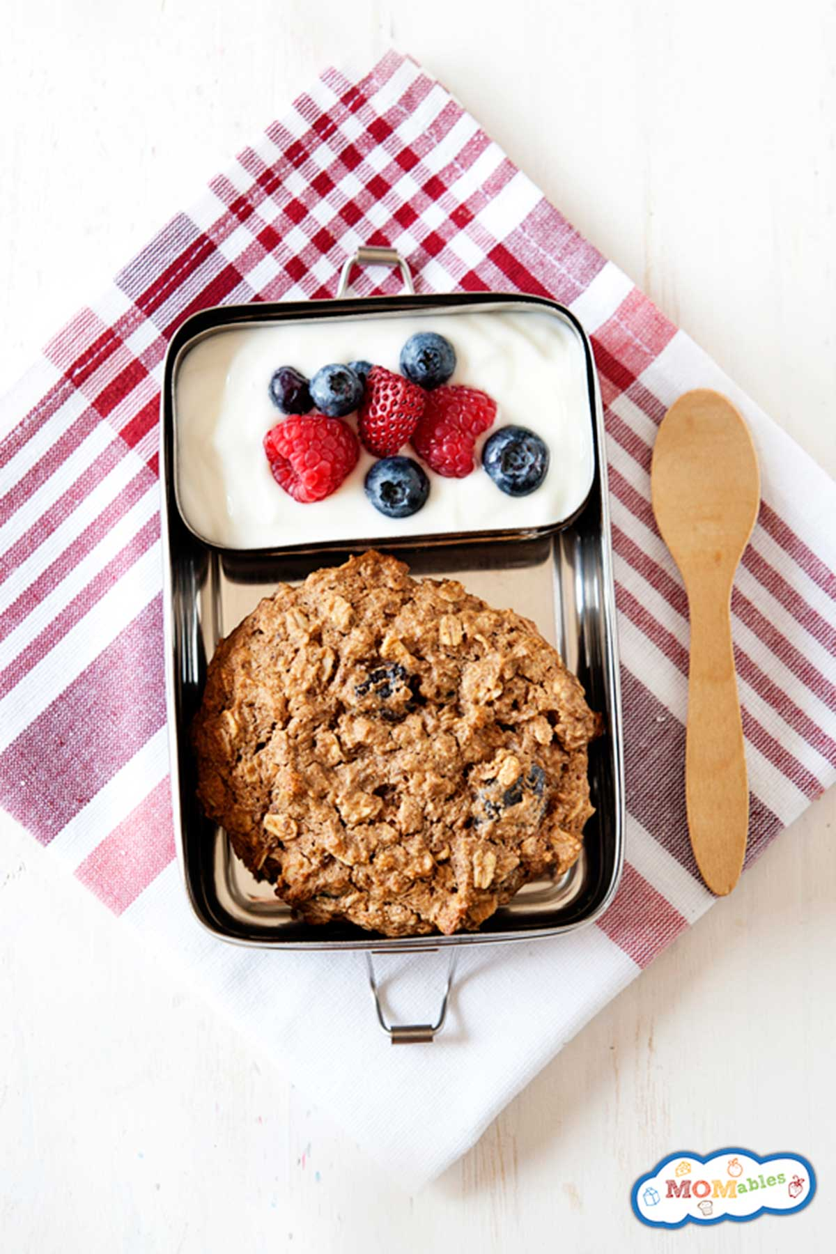 large breakfast cookie packed in lunch container with yogurt