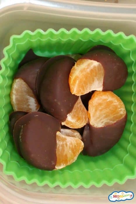 Image: chocolate dipped orange segments in a rubber cupcake liner.