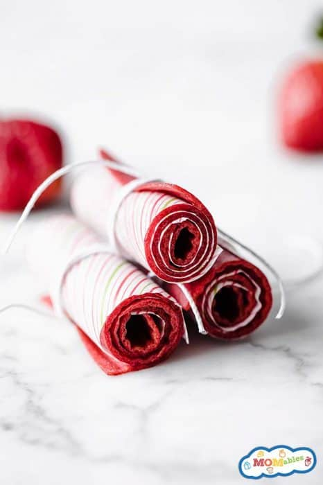 3 homemade fruit rolls up stacked together.