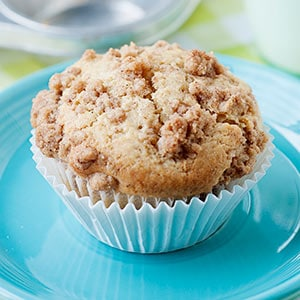 one pear muffin with crumble topping on a blue plate