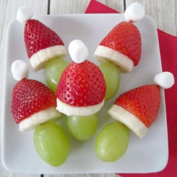 grapes topped with banana slices, strawberries and mini marshmallows
