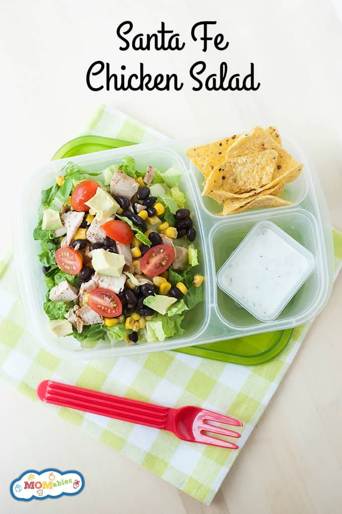 image: a clear lunch dish with chicken salad, a small dish of ranch dressing and chips.
