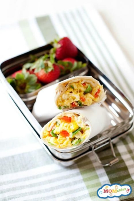image: homemade freezer breakfast burritos in a small lunchbx.