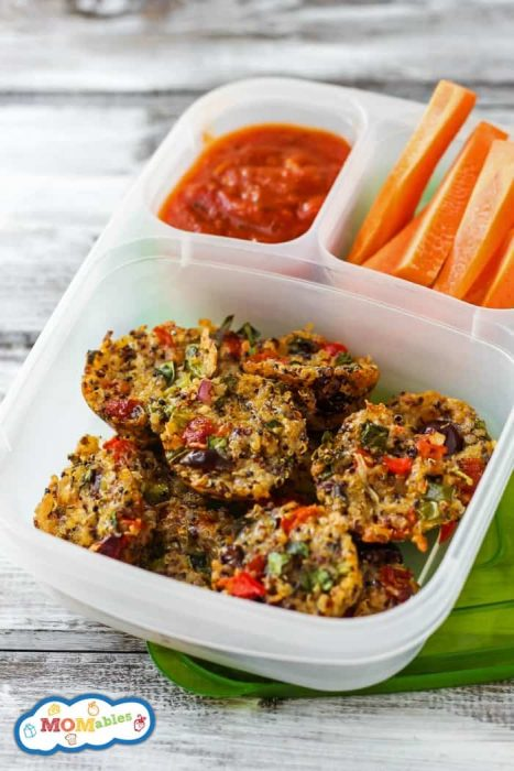 quinoa pizza bites in a lunch container with marinara sauce and carrot sticks