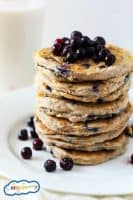 These fluffy Gluten Free Blueberry Pancakes are perfect topped with fresh fruit and maple syrup! They're also vegetarian/vegan & easy to make with the kids.