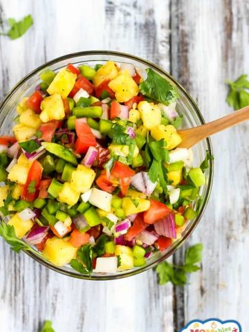 This easy Pineapple Salsa is the perfect combination of sweet and savory! Full of wholesome ingredients, it's a great snack or topping for tacos, chips & much more.