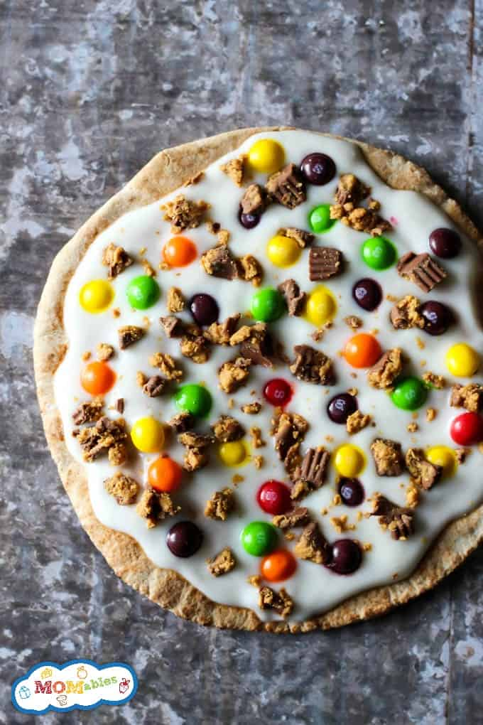 Don't know what to do with leftover Halloween candy? The kids will love a slice of this Halloween Candy Pizza as a special lunch box treat or fun dessert.