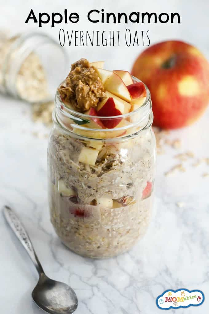 apple cinnamon overnight oats in a glass jar, topped with peanut butter and chopped apples.
