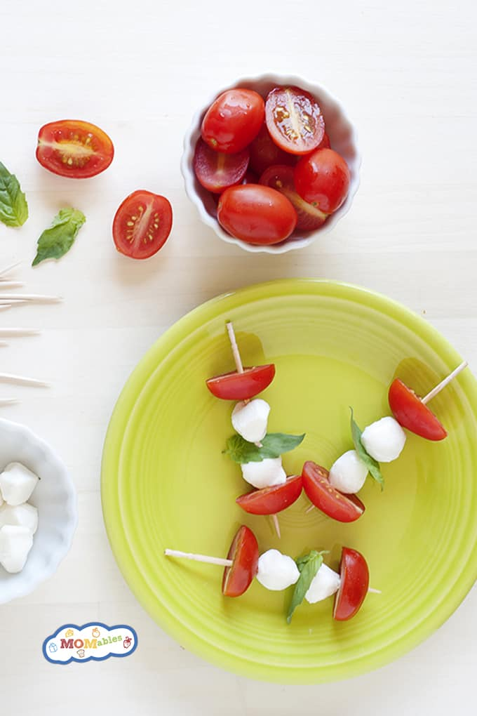 These Caprese skewers are quick and easy to make and are a terrific quick snack or a healthy school lunch, and don't forget the pesto!