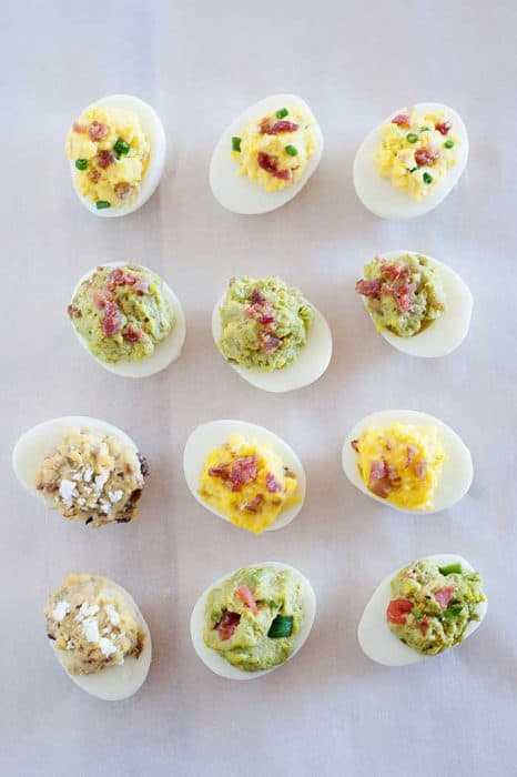 deviled eggs on countertop in rows of three