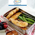 Image: baked parmesan chicken tenders with vegetables and fruit in a lunch container with marinara sauce on the side.