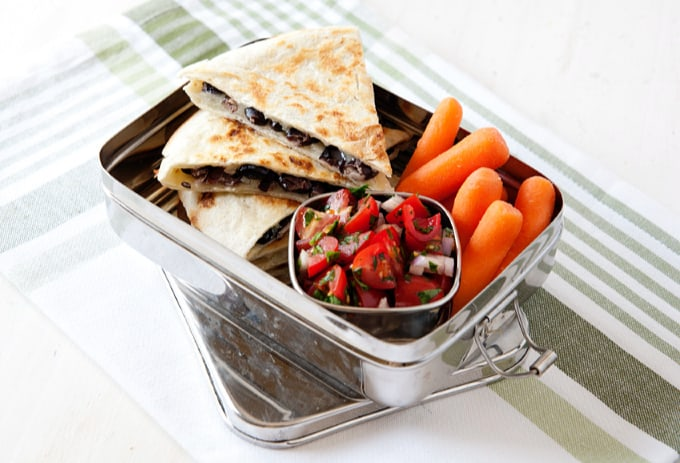 baby carrots, tomato salad and quesadilla slices in silver lunchbox