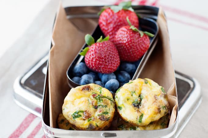 egg bites, and fruit in a small silver lunchbox