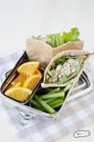 healthy salmon salad stuffed whole wheat pits with veggies and fruit