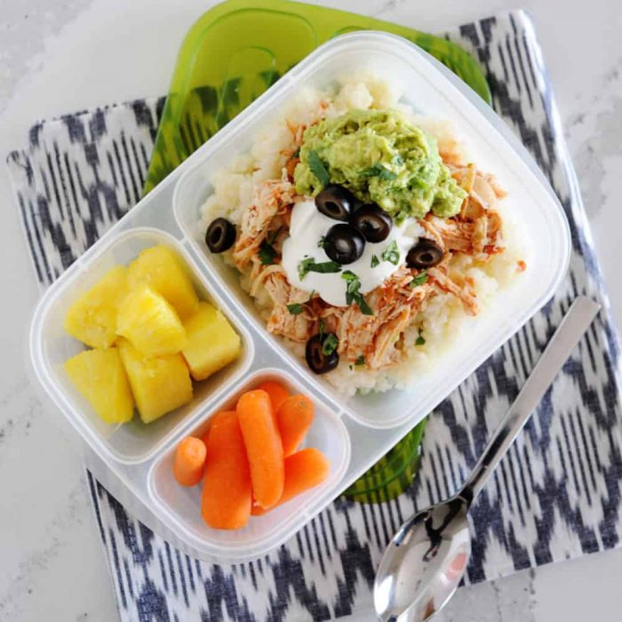 burrito bowl in a lunchbox with carrots and pineapple