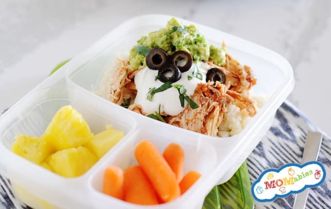 image: Chicken Burrito Bowl in a lunchbox container with pineapple cubes and carrot sticks