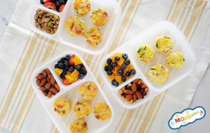 image: 3 Healthy Egg Cups in lunch containers with fruit and nuts
