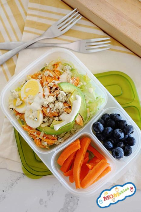 Image: Buffalo Chicken Salad with dressing in a divided lunch container.  Carrot sticks and blueberries fill the other two container sides.