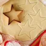 gluten free sugar cookie dough rolled out being cut into stars
