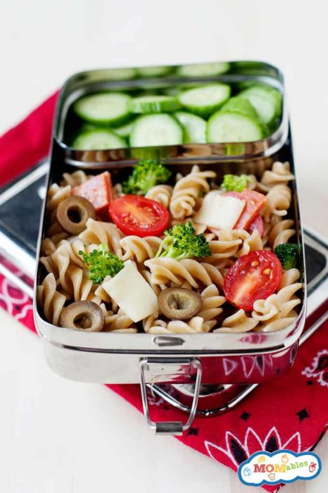 Image: overhead of pizza pasta salad in a lunch container with sliced cucumbers.