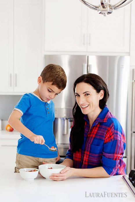 image: mom and son in kitchen cooking together.