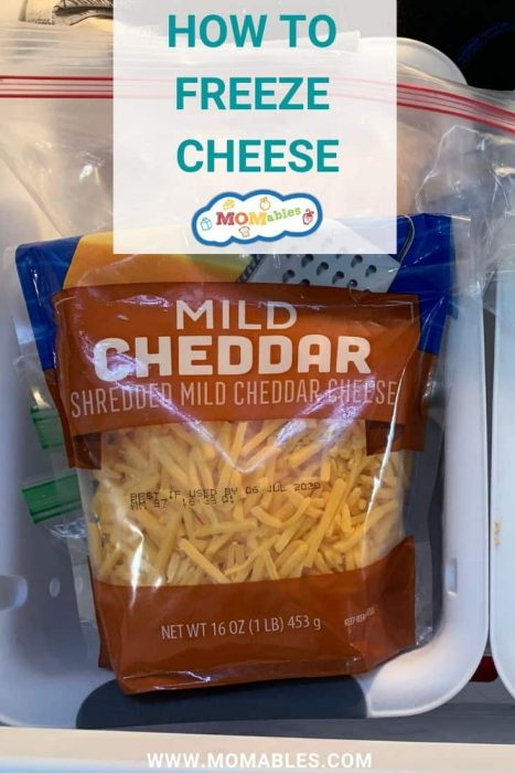 image: overhead shot - bag of shredded milk cheddar cheese in a freezer drawer.