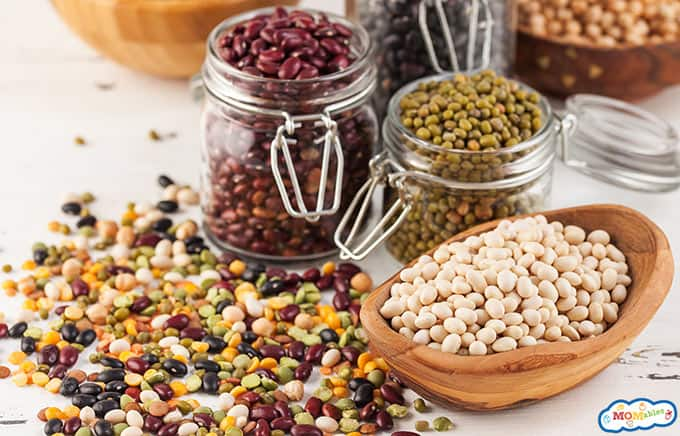 Image: an assortment of dried beans in jars and bowls.