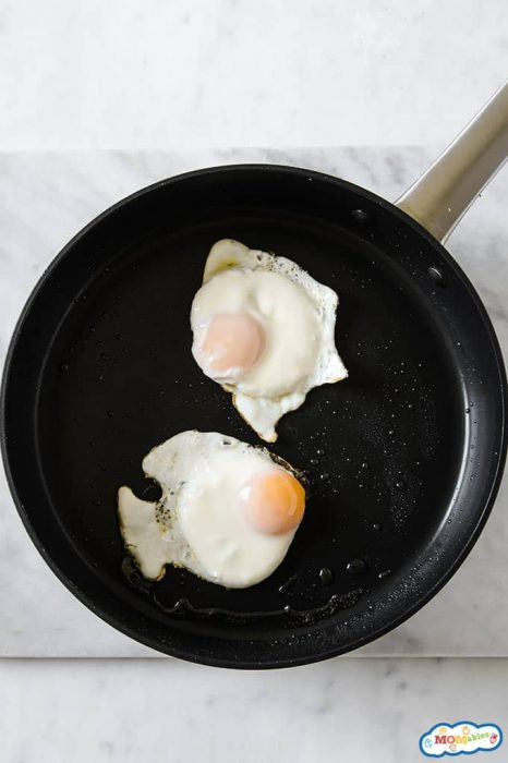 Image: Two fried eggs in a pan.