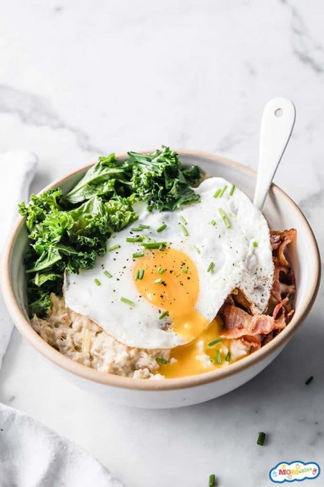Image: Fried egg over a bowl of savory oatmeal.