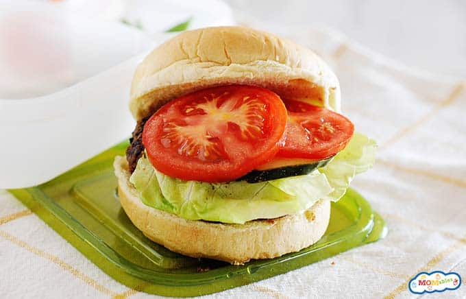 Image: black bean burger on a bun with lettuce and tomatoes