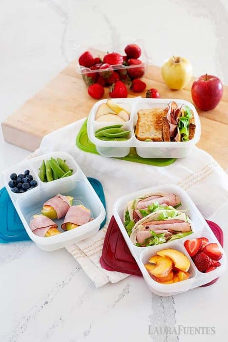 image: three open lunch containers on a counter filled with lunch inspiration for school lunches