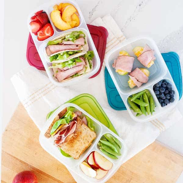 three lunchboxes with ham lunch options