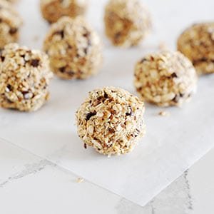 eight oatmeal bites on parchment paper.