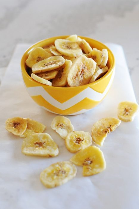 banana chips in a yellow bowl
