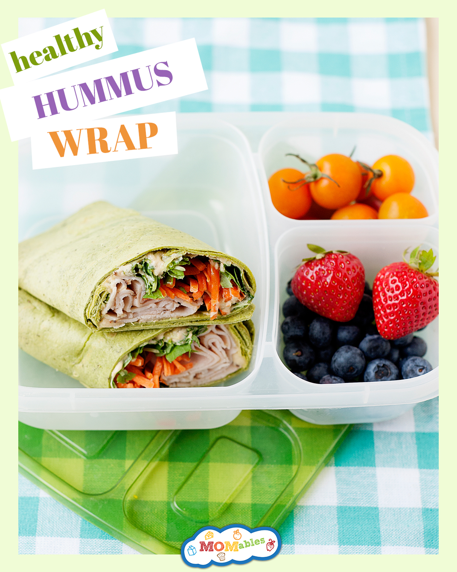 hummus wrap in a lunch container with berries