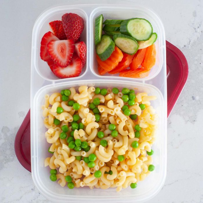 pasta salad in a snack box with fruit and veggie slices